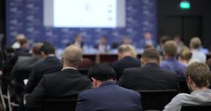 Hombres de negocios del seminario de la conferencia de la reunión de la oficina del concepto del entrenamiento Visión posterior C