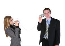 Hombres de negocios en el teléfono viejo Foto de archivo libre de regalías