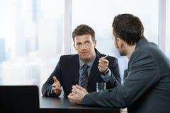 Hombres de negocios en la discusión Fotografía de archivo