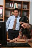 Hombres de negocios en la oficina Imágenes de archivo libres de regalías
