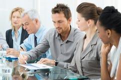 Hombres de negocios en la reunión Imagen de archivo libre de regalías