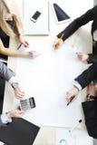 Hombres de negocios en la reunión Foto de archivo libre de regalías