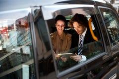 Hombres de negocios en taxi Imágenes de archivo libres de regalías