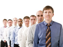 Hombres de negocios en una línea imagen de archivo libre de regalías