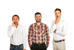 Hombres de negocios enojados, felices y asustados Fotos de archivo