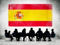 Hombres de negocios españoles que tienen una reunión imagen de archivo