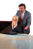 Hombres de negocios mayores delante de la computadora portátil Imágenes de archivo libres de regalías