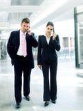 Hombres de negocios ocupados Imagenes de archivo