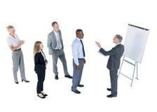 Hombres de negocios que aprenden de un hombre de negocios Imagen de archivo libre de regalías