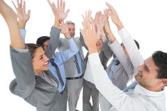 Hombres de negocios que aumentan sus brazos Foto de archivo libre de regalías