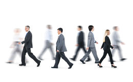Hombres de negocios que caminan en diversas direcciones Fotografía de archivo libre de regalías