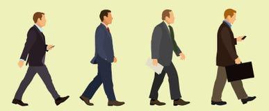 Hombres de negocios que caminan en trajes Imagen de archivo