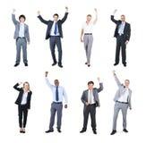 Hombres de negocios que celebran con sus manos aumentadas Foto de archivo