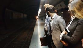 Hombres de negocios que esperan el subterráneo Imágenes de archivo libres de regalías