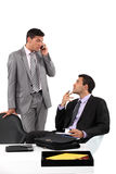 Hombres de negocios que esperan pacientemente Imágenes de archivo libres de regalías