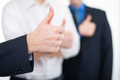 Hombres de negocios que gesticulan los pulgares para arriba Fotos de archivo libres de regalías