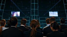 Hombres de negocios que miran una etapa digital almacen de video