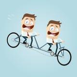 Hombres de negocios que montan una bici en tándem Imagen de archivo libre de regalías