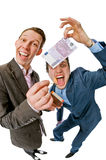 Hombres de negocios que queman 500 euros Imagen de archivo libre de regalías