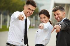 Hombres de negocios que señalan en usted Foto de archivo libre de regalías