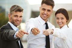Hombres de negocios que señalan en usted Imagen de archivo libre de regalías