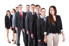 Hombres de negocios que se colocan en fila Foto de archivo libre de regalías