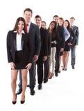 Hombres de negocios que se colocan en fila Imagen de archivo libre de regalías