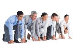 Hombres de negocios que se preparan para correr Foto de archivo