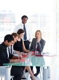 Hombres de negocios que trabajan en una reunión Imágenes de archivo libres de regalías