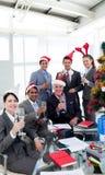 Hombres de negocios que tuestan en un partido Fotos de archivo libres de regalías