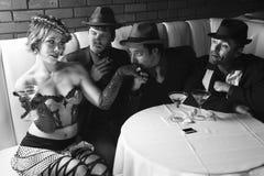 Hombres de negocios retros con la muchacha. Imagen de archivo libre de regalías