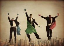 Hombres de negocios retros del super héroe Fotos de archivo libres de regalías