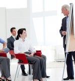 Hombres de negocios serios en una conferencia Fotos de archivo