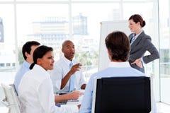 Hombres de negocios serios en una presentación Fotografía de archivo libre de regalías