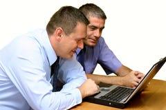 Hombres de negocios - trabajando junto Fotografía de archivo libre de regalías
