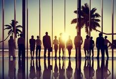Hombres de negocios traseros del verano del Lit del concepto corporativo de la unidad Imagen de archivo libre de regalías