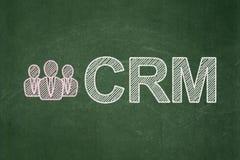 Hombres de negocios y CRM en fondo de la pizarra Imagen de archivo libre de regalías