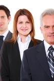 Hombres de negocios y empresaria Imagenes de archivo