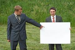 Hombres de negocios y hoja del papel Imágenes de archivo libres de regalías