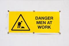 Hombres del peligro en el trabajo Fotos de archivo