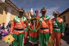 Hombres en el desfile del Corpus Christi en Pujili Ecuador Imagen de archivo libre de regalías