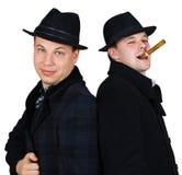 Hombres en sombrero con el cigarro Imagenes de archivo