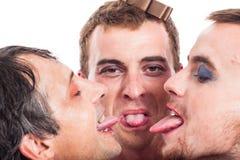 Hombres extraños que pegan hacia fuera la lengua Fotografía de archivo