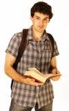 Hombres hermosos jovenes aislados con el libro y la mochila Fotografía de archivo libre de regalías