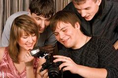 Hombres jovenes con photocamera Imagen de archivo