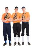 Hombres jovenes en la forma de un juego de béisbol Imagenes de archivo