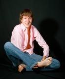 Hombres jovenes sonrientes en color de rosa Fotografía de archivo