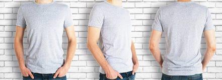 Hombres que llevan la camisa gris vacía imágenes de archivo libres de regalías