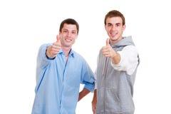 Hombres que muestran los pulgares para arriba Fotografía de archivo libre de regalías