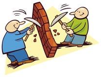 Hombres que rompen la pared Imágenes de archivo libres de regalías